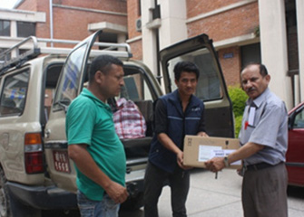 Distribution of Clothes and Handing over Medicines